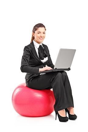 business women on ball