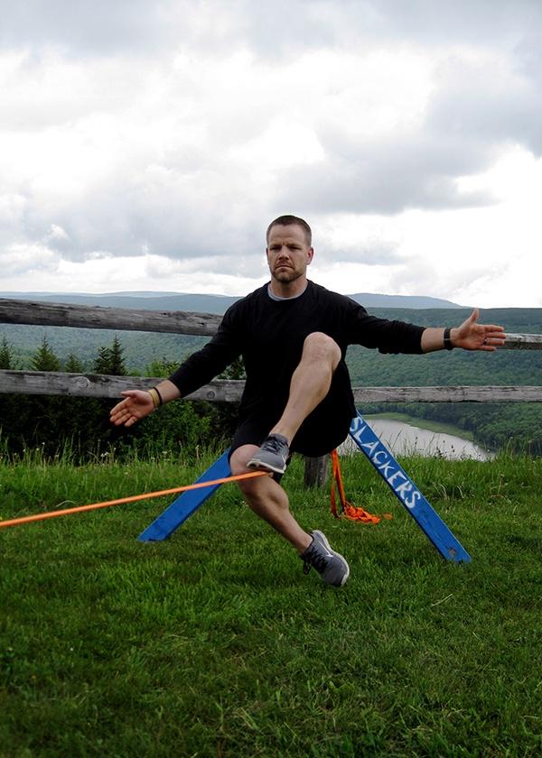 YogaSlackers-_-Day-1-_-Tony-sitting-on-slackline-Photo-2.jpg
